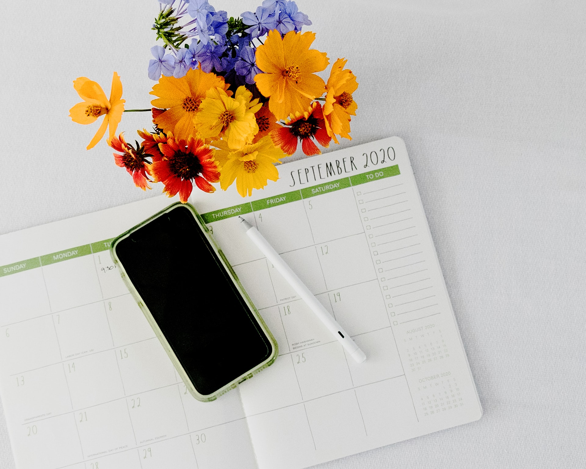 diary with pen and flowers