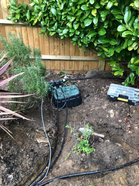 automatic watering system being installed